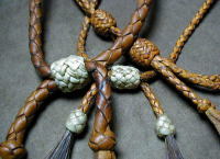 Deer leather and knot work with rawhide